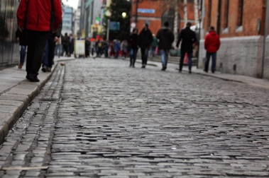 The cobblestoned streets of Temple Bar, the hub of Dublin's cultural quarter and home of nightlife today.