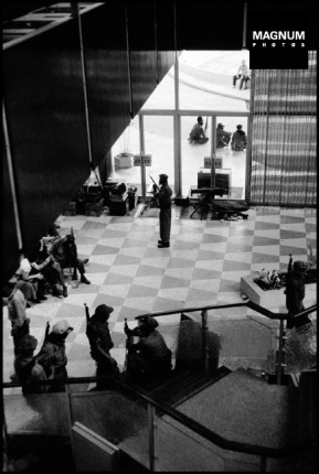 CUBA. La Havana. 1959. After Batista left La Havana, Castro's forces began arriving. Here they are establishing an informal headquarters in the lobby of the Hilton Hotel. ©BurtGlinn/Magnum